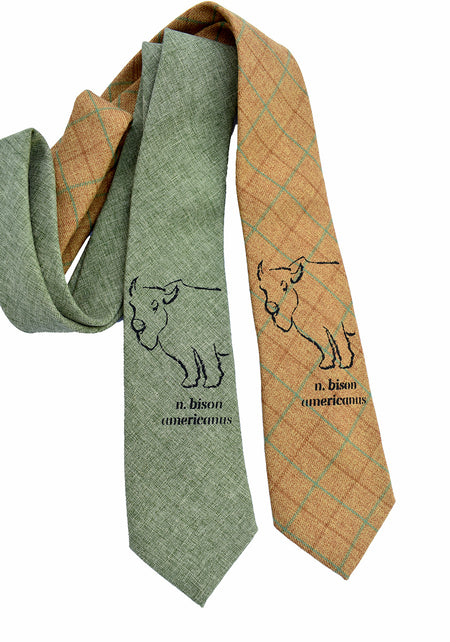 Bison Americanus cotton tie in mustard and green. Regular length and width. 100% cotton with black design of a bison with the words Bison Americanus. Uniquely American Clothing that Matters.