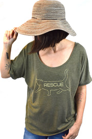 Bob heather olive slouchy tee with cream hand printed design of bob the cat with the word Rescue inside the image on model with sun hat. Donation goes to the ASPCA. Buy One Give a Pair donation of socks to a featured shelter with every item sold. Common Interest Clothing.