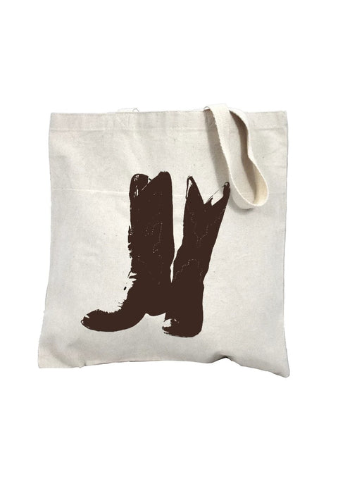 Boots natural canvas library bag with chocolate ink of a cowboy boots with stitching detail. Buy One Give a Pair donation of socks to a featured shelter with every item sold. Common Interest Clothing