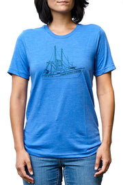 Carolina trawler heather true royal blue, short sleeve, crew neck tee, t-shirt with navy hand-printed design of a Carolina Trawler fishing boat and the words Common Interest Clothing along the hull. A pair of socks will be donated to a featured shelter through our Buy One, Give a Pair program with every item purchased. Common Interest Clothing.
