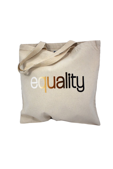 Color blind natural canvas library bag with skin color blended hand-print of the word equality for racial equality. Donation goes to the Equal Justice Initiative. Buy One Give a Pair donation of socks to a featured shelter with every item sold. Common Interest Clothing
