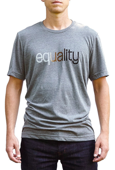 Color blind deep heather gray, short sleeve, crew neck tee, t-shirt with skin color blended hand-print of the word equality for racial equality. Donation goes to the Equal Justice Initiative. Buy One Give a Pair donation of socks to a featured shelter with every item sold. Common Interest Clothing