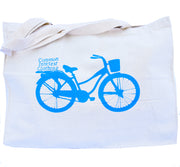 Cruiser bag with Common Interest Clothing logo on back of cruiser bicycle. Cruiser is printed in light blue color on a natural cotton canvas bag with gusset. Uniquely American Clothing that Matters.