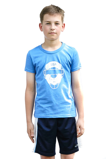 Kid's Full Count heather royal blue, short sleeve, crew neck tee, t-shirt with white design of baseball catcher's mask and the word USA in the top section of the image. A pair of socks will be donated to a featured shelter through our Buy One, Give a Pair program. Uniquely American Clothing that Matters. Common Interest Clothing