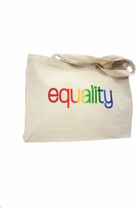 Love natural canvas gusset bag with rainbow color blended hand-print of the word equality for LGBTQ equality. Donation goes to The Trevor Project. Buy One Give a Pair donation of socks to a featured shelter with every item sold. Common Interest Clothing