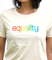 Love cream, short sleeve, crew neck tee, t-shirt with rainbow color blended hand-print of the word equality for LGBTQ equality. Donation goes to The Trevor Project. Buy One Give a Pair donation of socks to a featured shelter with every item sold. Common Interest Clothing