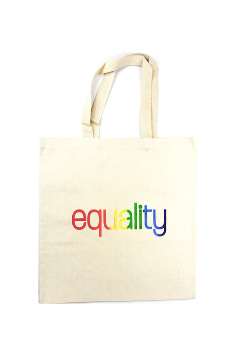 Love natural canvas library bag with rainbow color blended hand-print of the word equality for LGBTQ equality. Donation goes to The Trevor Project. Buy One Give a Pair donation of socks to a featured shelter with every item sold. Common Interest Clothing