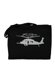 Ninth Tour black canvas gusset bag with light gray hand-printed design of a pave hawk helicopter and the word Freedom in script above the propellers. A pair of socks will be donated to a featured shelter through our Buy One, Give a Pair program with every item purchased. Common Interest Clothing.