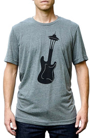 Seattle Sound deep heather gray, short sleeve, crew neck tee, t-shirt with black hand-printed design of a guitar turning into the Seattle Space Needle. A pair of socks will be donated to a featured shelter through our Buy One, Give a Pair program with every item purchased. Common Interest Clothing.