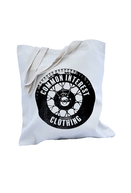 Tread natural cotton canvas library shopping bag with black tire design. Uniquely American Clothing that Matters.