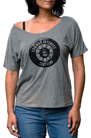 Tread gray triblend slouchy tee with black hand-printed design of a tire and the words Common Interest Clothing as the logo. A pair of socks will be donated to a featured shelter through our Buy One, Give a Pair program with every item purchased. Common Interest Clothing.
