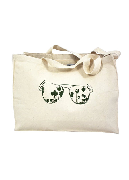 Venice Beach natural canvas gusset bag with green hand-printed design of aviators reflecting the boardwalk of Venice Beach, California. A pair of socks will be donated to a featured shelter through our Buy One, Give a Pair program with every item purchased. Common Interest Clothing.