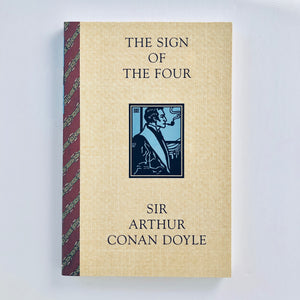 Paperback book: The Sign of the Four by Sir Arthur Conan Doyle