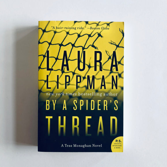 Paperback book: By a Spider's Thread by Laura Lippman