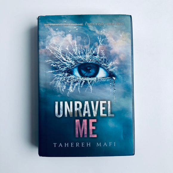 Hardcover book: Unravel Me by Tahereh Mafi