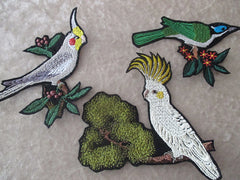 Embroidered bird patches