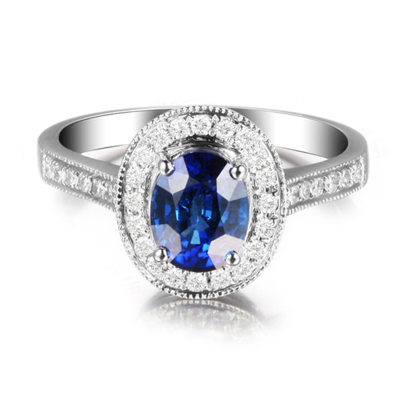 Vintage Blue Oval Created Sapphire Halo Rings