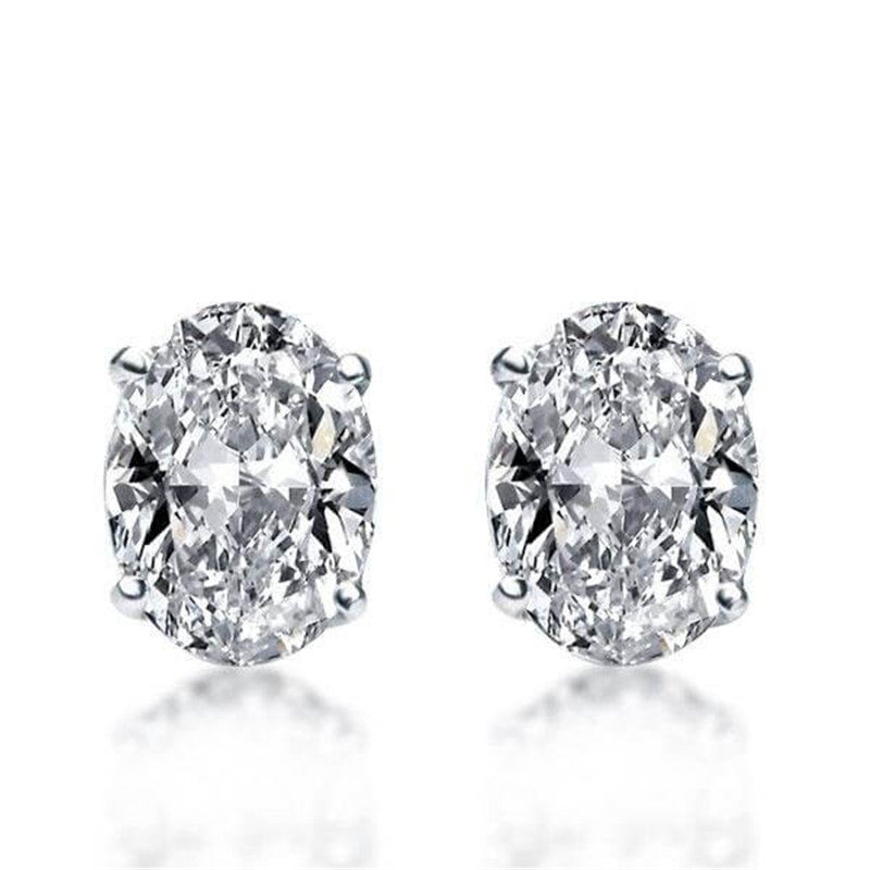 Oval Created White Diamond Solitaire Stud Earrings