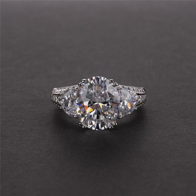Oval Cut Three Stone Created Diamond Ring