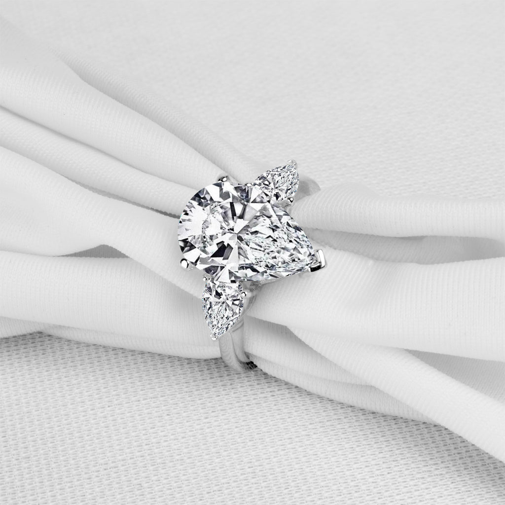 Pear Shape Three Stone Created White Diamond Ring