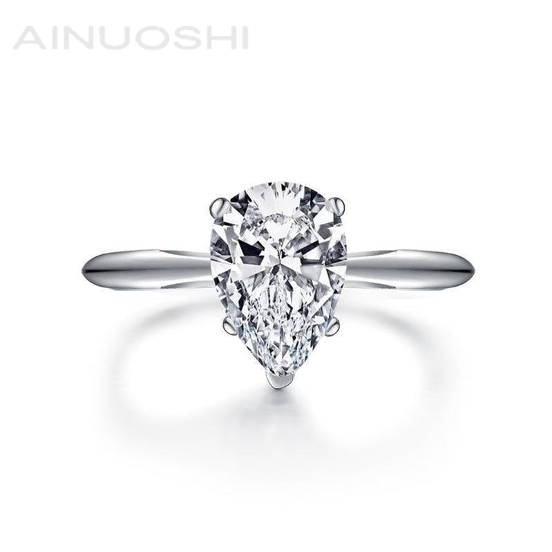 Classic Solitaire Pear Created White Diamond Ring