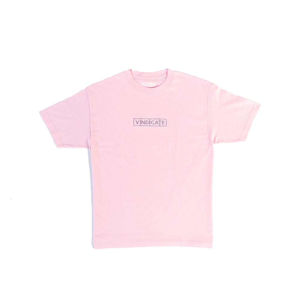 pink t-shirt with a purple multi coloured vindicate logo on the chest