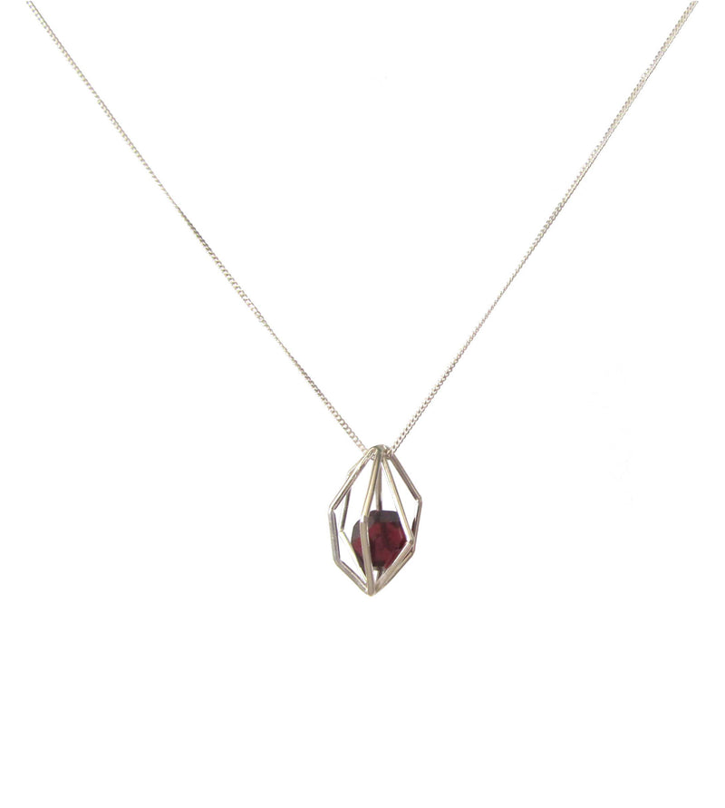 Faceted semi-precious Garnet loose in sterling silver geometric cage on sterling silver necklace chain.