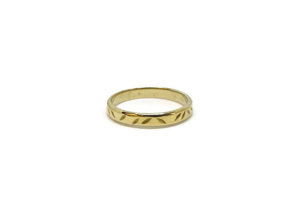 Brass ring with comfortable fit and polished finish with subtle floral detail.