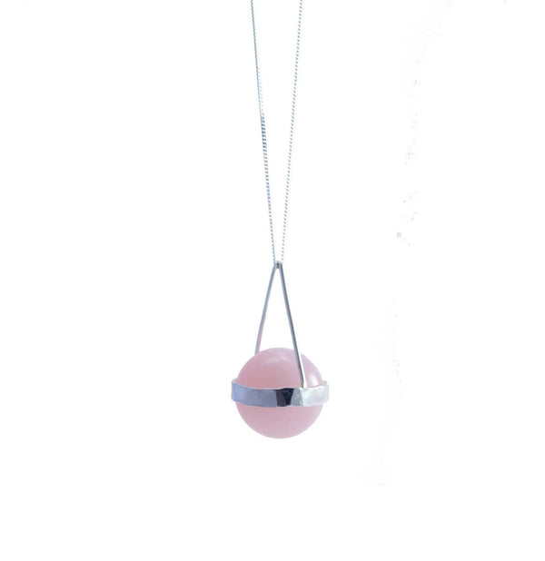 Semi-precious stone set in sterling silver setting on sterling silver chain.