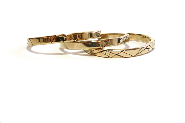 Brass bangle with geometric motif.