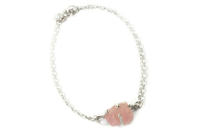 Semi-precious un-cut gemstone set in sterling silver claws with silver bracelet chain