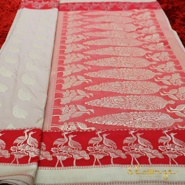 Ivory & Pink Banarasi Silk Saree With All-Over Figure Motifs