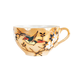 Orange Tea Cup With Foliage Design