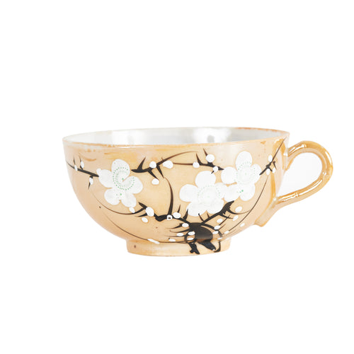 Orange Tea Cup With Blossom Design