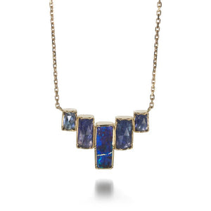 Brooke Gregson | Designer Jewelry An 18k yellow gold gemstone necklace with tanzanite and opal stones.