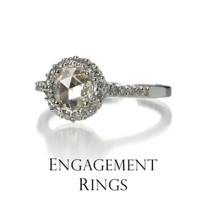 Begin life together with an eternal symbol of love's strength. Diamonds dazzle in all shapes, cuts and colors in settings as unique as your love. A seamless blend of traditional and alternative, this Paul Morelli diamond engagement ring is breathtaking.