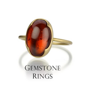 Crush on these candy gems set in gold and silver in every color of the spectrum. Filled with warmth and rich color, this Gabriella Kiss ring showcases an oval spessartite garnet framed in her 18k yellow gold scalloped bezel.