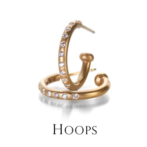 On-trend and always in style, a great pair of hoop earrings are a jewelry box must! These Reinstein/Ross diamond hoops take it one step further with the ability to add interchangeable gemstone drops.