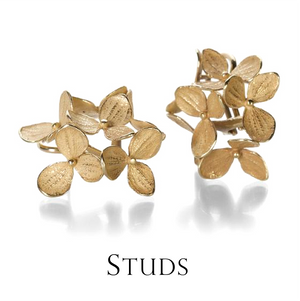 There is literally a stud earring for all tastes, from chunky diamonds to delicate flowers. This John Iversen design features an artful rendition of nature cast 18k yellow gold hydrangea blossoms, a tiny bouquet!