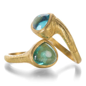 A set of two 22k yellow gold, interlocking apatite rings with hand engraved bands handcrafted by Lilly Fitzgerald.