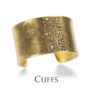 A wide, 18k yellow gold scratched texture cuff with nature colored rose cut diamonds by the jewelry designer Todd Reed. Fine jewelry, designer jewelry, boston jewelry store, diamond cuff, diamond bracelet, handmade jewelry, unique jewelry, statement cuff
