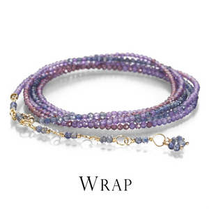An 18k yellow gold wrap bracelet with faceted amethyst, iolite and garnet beads by the jewelry designer Anne Sportun. Fine jewelry, designer jewelry, gemstone wrap bracelet, gemstone jewelry, unique jewelry, boston jewelry store, artist jewelry