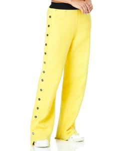 TROUSERS WITH SIDE BUTTONS IN YELLOW