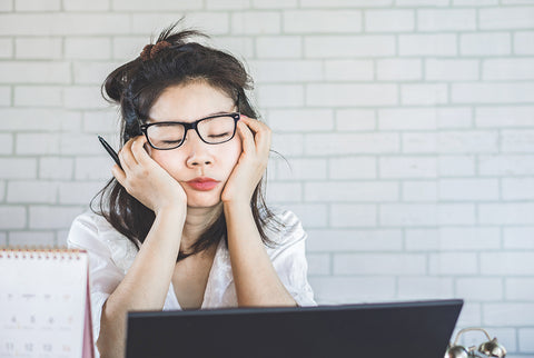 Tired office worker at computer