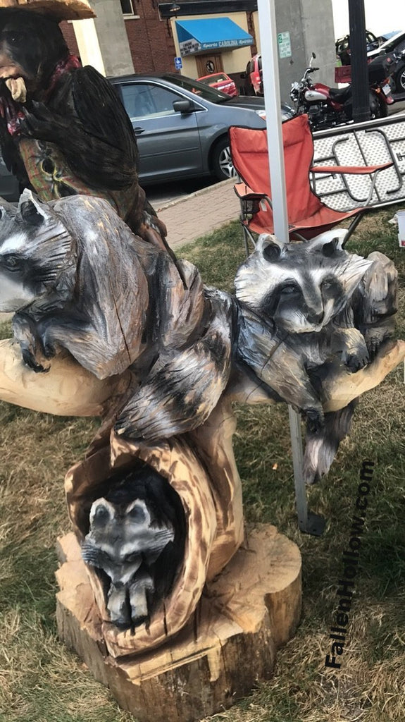 Chainsaw carving raccoons u2013 fallen hollow creations
