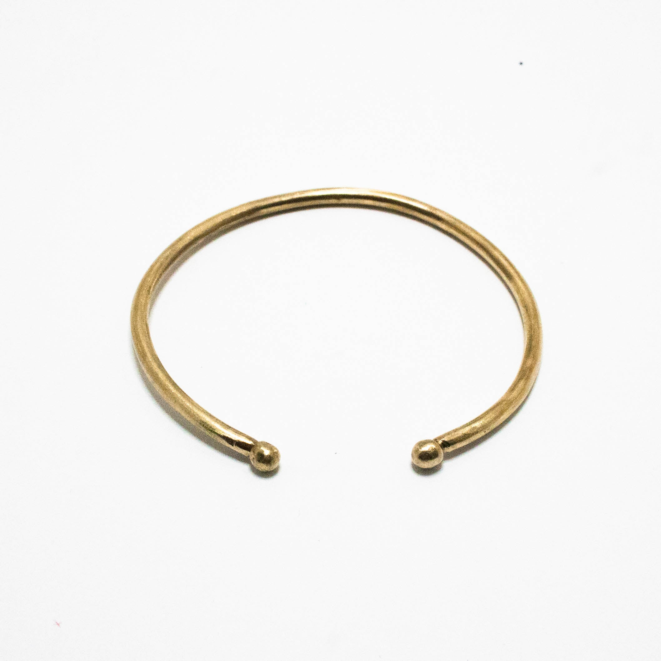 Brass cuff with balled ends