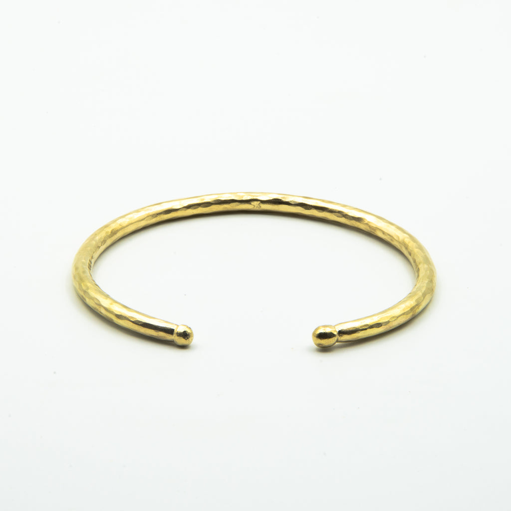 thick brass cuff with balled ends, front view on white background