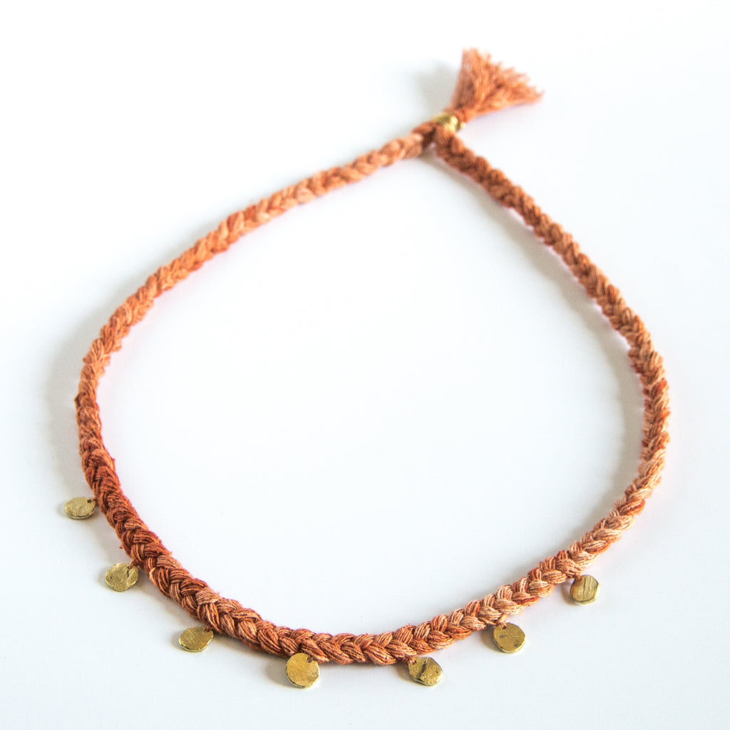 Orange silk braid necklace with seven circle pendants