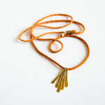Orange silk rope necklace with brass pendants