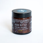 body butter in amber glass pot